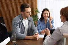 Lawyer having meeting with young couple