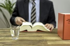 Lawyer in his office with books Stock Images