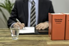 Lawyer in his office with books Royalty Free Stock Photos