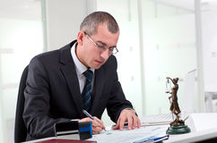 Lawyer on his workplace. Lawyer or notary public at contemporary office stock image