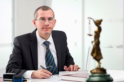 Lawyer on his workplace. Lawyer or notary public at contemporary office royalty free stock image