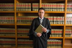 Lawyer holding book in the law library Royalty Free Stock Image