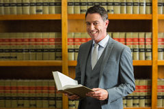 Lawyer holding book in the law library Stock Images