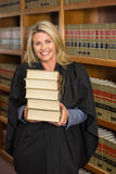 Lawyer holding books in the law library Stock Image