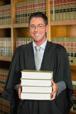 Lawyer holding books in the law library Royalty Free Stock Images
