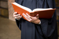 Lawyer holding a law book Stock Images