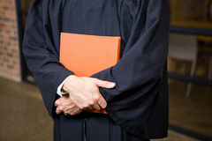 Lawyer holding a law book. In office Royalty Free Stock Photography