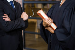 Lawyer holding a law book. In office Royalty Free Stock Images