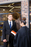 Lawyer interacting with businessman Royalty Free Stock Images