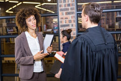 Lawyer interacting with businesswoman Stock Images