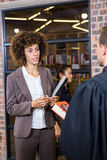 Lawyer interacting with businesswoman Royalty Free Stock Image