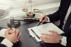 Lawyer or judge consult, meeting with client. Male lawyer working with contract papers. Lawyer or judge consult, meeting with client. Law and Legal services royalty free stock image