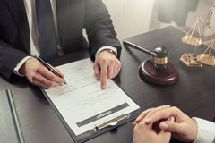 Lawyer or judge consult, meeting with client. Male lawyer working with contract papers. Lawyer or judge consult, meeting with client. Law and Legal services stock image