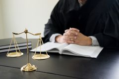 lawyer judge reading documents at desk in courtroom stock images