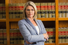 Lawyer looking at camera in law library Stock Images