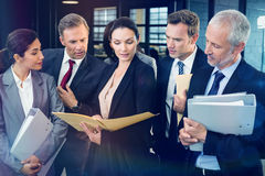 Lawyer looking at documents and interacting with businesspeople Royalty Free Stock Image