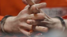 Lawyer making notes at interrogation meeting with prisoner, hands close up stock video