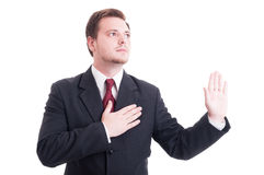 Lawyer making oath or swearing gesture. With one hand on the heart and the other one up Royalty Free Stock Photography