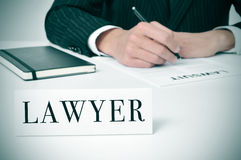 Lawyer. A man in his desk with a nameplate in front of him with the word lawyer written in it stock image