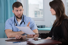 Lawyer of medical error victim. Picture of guilty doctor and lawyer of medical error victim royalty free stock photo