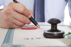 Lawyer, notary. Signs the documents from our office stock photography