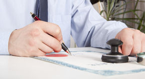 Lawyer, notary. Signs the documents from our office stock images
