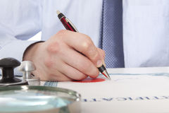 Lawyer, notary. Signs the documents from our office stock photos