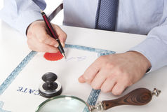 Lawyer, notary. Signs the documents from our office royalty free stock image