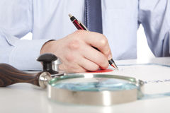 Lawyer, notary. Signs the documents from our office royalty free stock photo