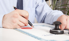 Lawyer, notary. Signs the documents from our office stock photo