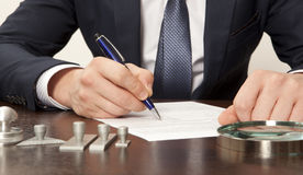 Lawyer. Notary signs the documents from our office royalty free stock image