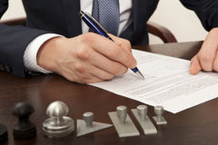 Lawyer. Notary signs the documents from our office royalty free stock photo