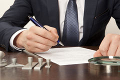 Lawyer. Notary signs the documents from our office royalty free stock photos