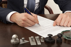 Lawyer. Notary signs the documents from our office royalty free stock photography