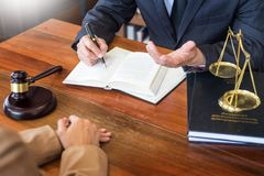 Lawyer in office. Counseling and giving advice about legal legislation in courtroom to help customer, tribunal and justice concept stock photography