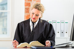 Lawyer in office with law book working on desk Stock Photos