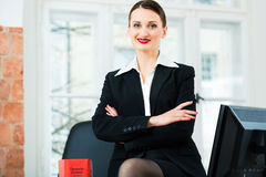 Lawyer in office with law book Stock Photography