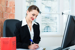 Lawyer in office with law book Stock Images