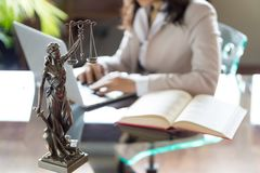Lawyer office. Statue of Justice with scales and lawyer working stock photos