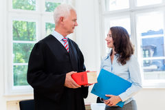 Lawyer and paralegal in their law office royalty free stock photo