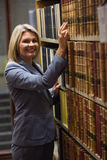 Lawyer picking book in the law library Stock Photos