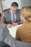 Lawyer preparing contract for clients Stock Images
