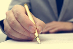 Lawyer is  preparing  contract with gold fountain pen. Vintage l Stock Photo