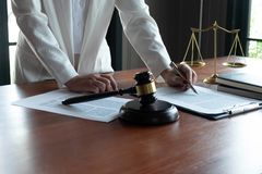The lawyer provides advice, advice, legal proposals. Examination of legal documents.  stock photo