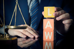 The lawyer puts LAW word. Attorney and lawyer concept Stock Image
