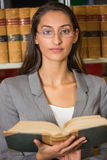 Lawyer reading book in the law library Royalty Free Stock Photo