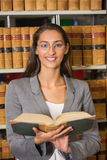 Lawyer reading book in the law library Stock Photography