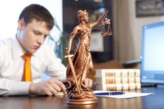 Lawyer reading a book royalty free stock photography
