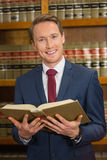 Lawyer reading in the law library Royalty Free Stock Photos