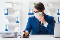 The lawyer receiving money as bribe. Lawyer receiving money as bribe Stock Photo
